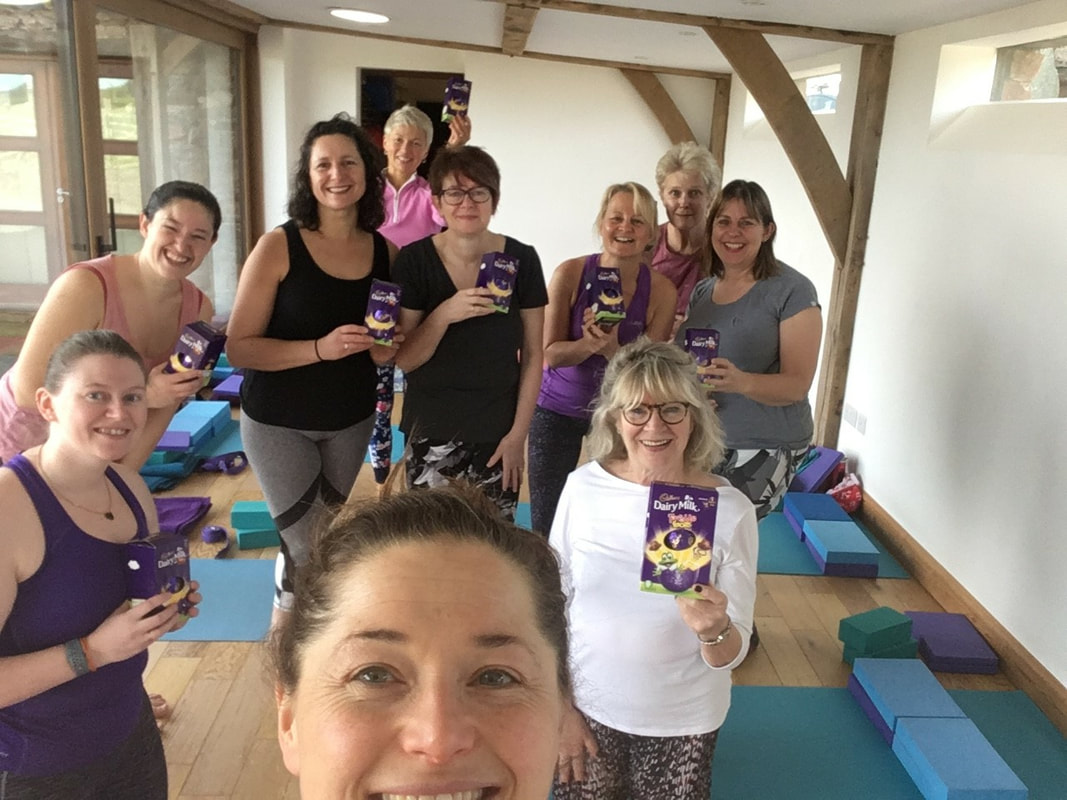 Photo of yoga group with easter eggs