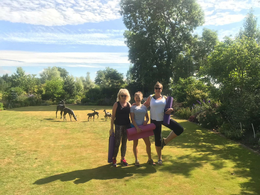 Picture of yoga on the lawn at larch cottage